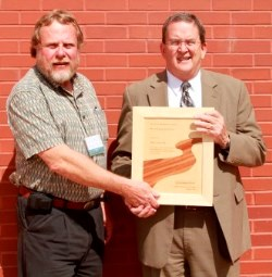 Dennis Willis, RMS President (left) presents 2013 River Manager of the Year Award to Greg Trainor