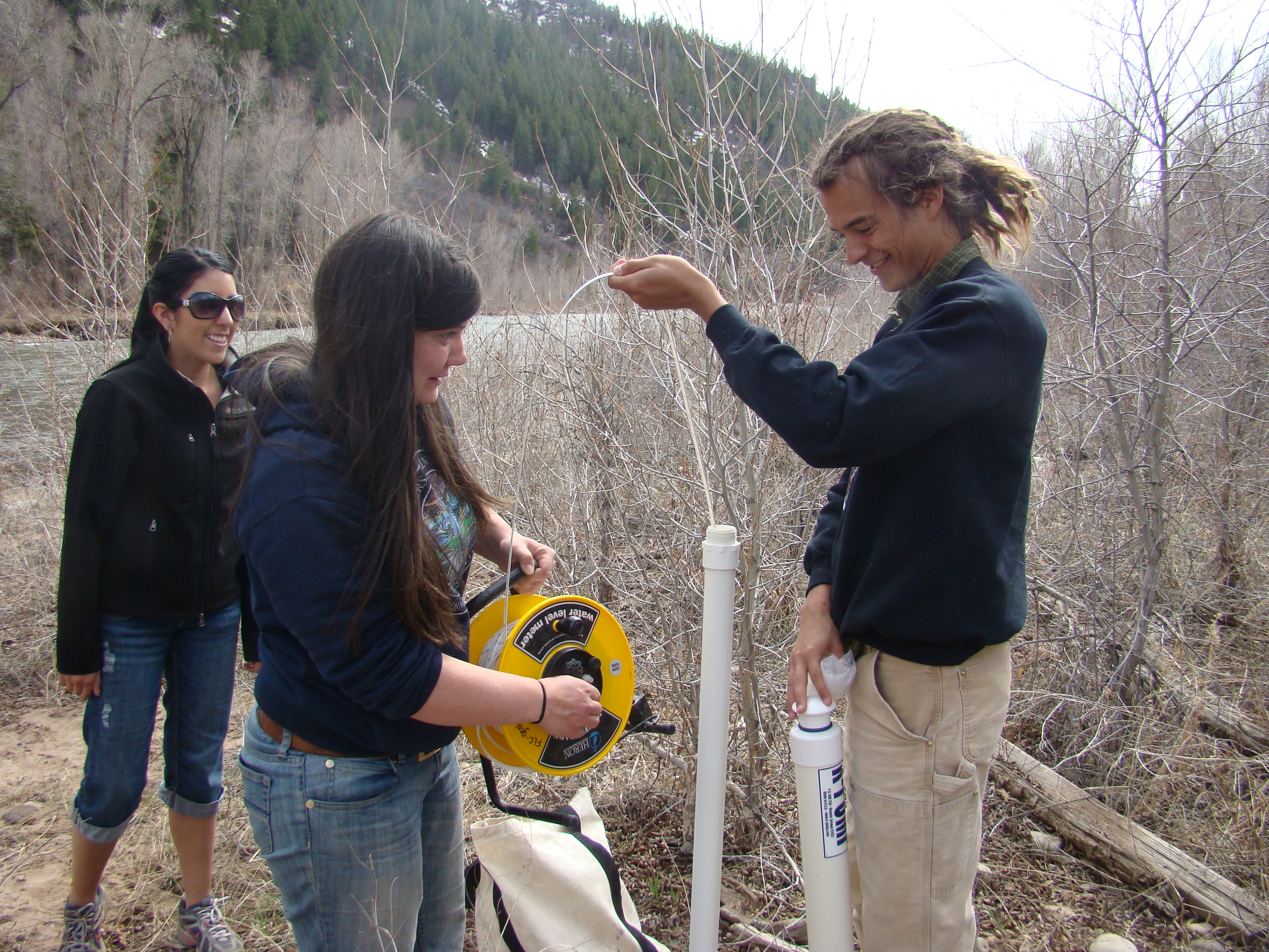 Photo by Dr. Gigi Richard. FLC students measure groundwater levels in the alluvial aquifer adjacent to the Dolores River in western Colorado