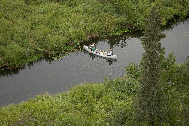 Photo by: Steve Hillebrand. Kenai, AK, wilderness canoeist-fisherman Swanson River.